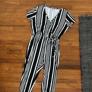 Black and white striped jumper. Size Medium